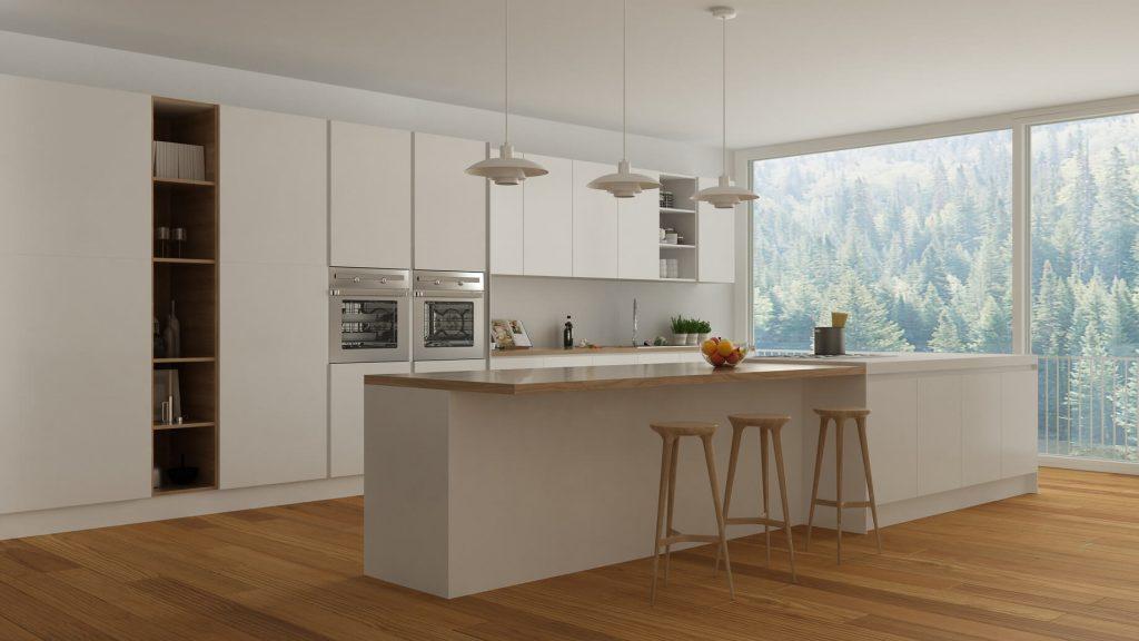 Cocina blanco mate con gola vertical, se deja espacio para situar taburetes